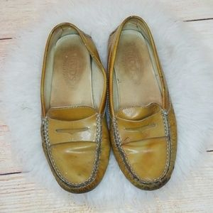 Tod's slip on yellow gold penny loafer flats 7.5